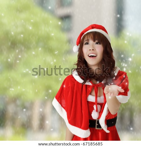Happy Christmas girl in outside with snowflakes falling. - stock photo