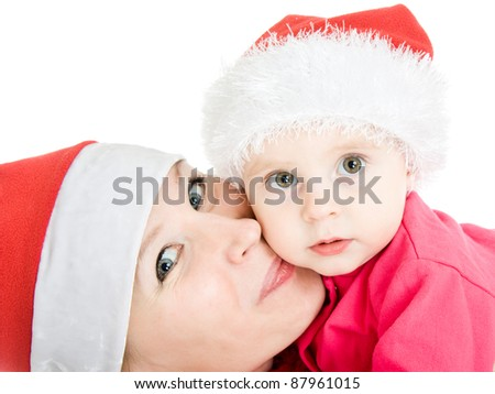 Happy Christmas mother kissing daughter on a white background. - stock photo