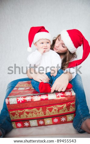 Happy Christmas mother with baby son on a white background. - stock photo