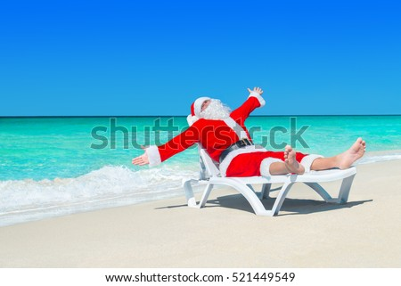 Happy Christmas Santa Claus on white beach bed at ocean sandy beach welcome gesturing his hands very happy with travel to hot tropical destinations