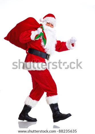 Happy Christmas Santa Claus with bag. Isolated on white background. - stock photo