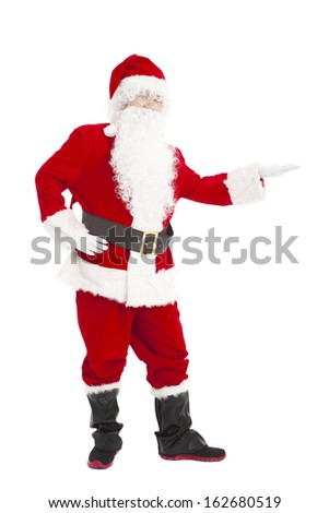 Happy Christmas Santa Claus with showing gesture - stock photo