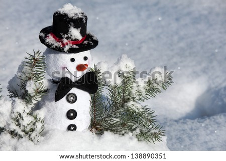 Happy Christmas snowman  in snow - stock photo