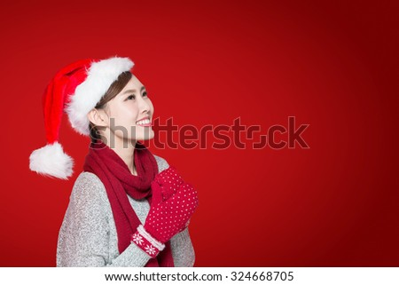 Happy Christmas Woman isolated on red background, asian