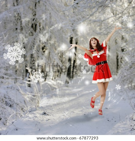 Happy Christmas woman open arms in snow forest. - stock photo