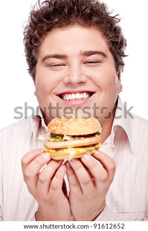 Happy chubby holding a hamburger, isolated on white
