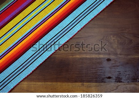 Happy Cinco de Mayo, 5th May, party table background with red, yellow and blue colors against dark wood recycled timber table. - stock photo
