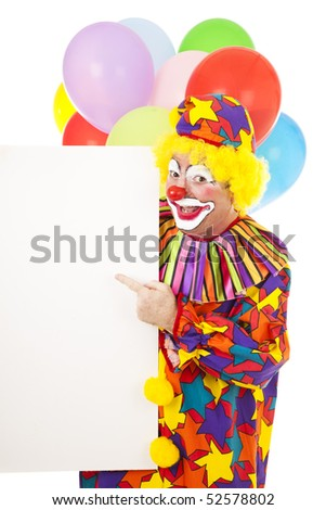 Happy circus clown pointing to a blank sign, ready for your text.  Isolated on white. - stock photo