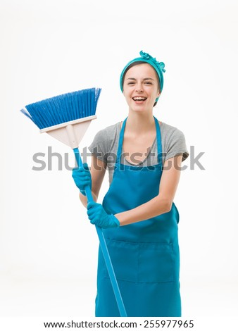 happy cleaning lady standing, holding broom and laughing. isolated on white background - stock photo