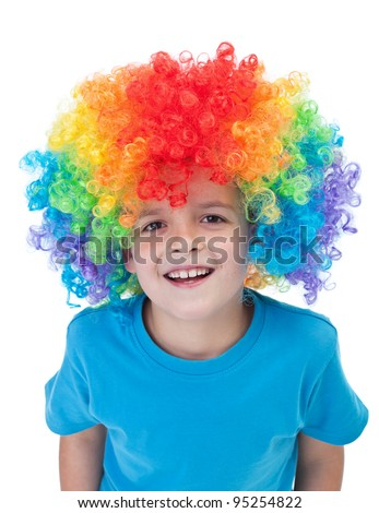 Happy clown boy with large colorful wig - isolated - stock photo