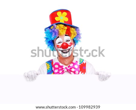 Happy clown holding the blank board