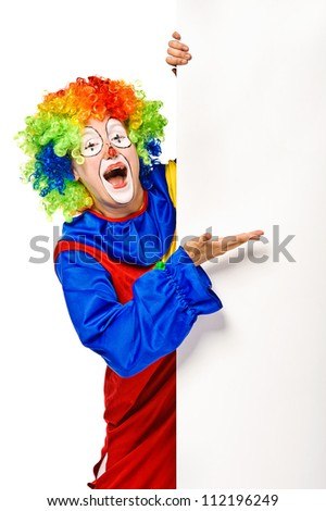 Happy clown holding the blank board. Isolated - stock photo