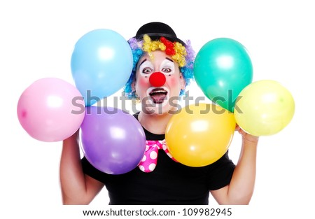 Happy clown on a white background holding colorful balloons - stock photo