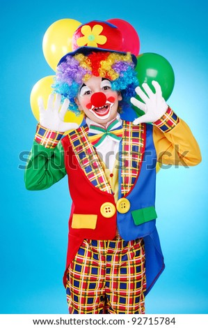 Happy clown over the blue background - stock photo
