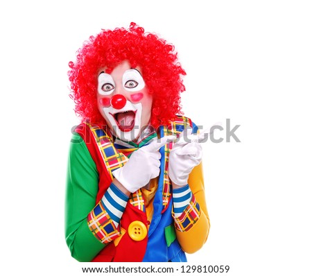 Happy clown pointing to the copy space area - stock photo