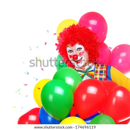 happy clown surrounded by colored air balloons