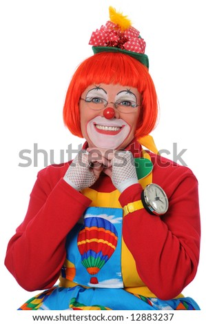 Happy clown with hands on chin isolated over a white background - stock photo