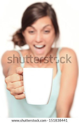 happy coffee junkie - blurry face with focus on the big white cup with copy space - isolated on white - stock photo