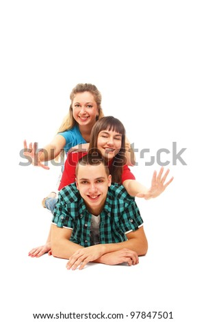 Happy college friends lying on the floor, isolated on white background