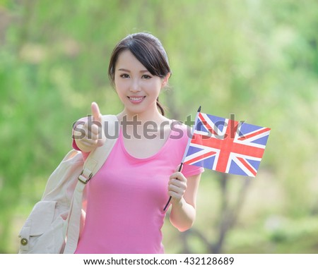 Happy College Student girl hold British flag and show thumb up with nature white background, asian