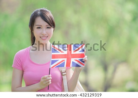 Happy College Student girl hold British flag with nature white background, asian