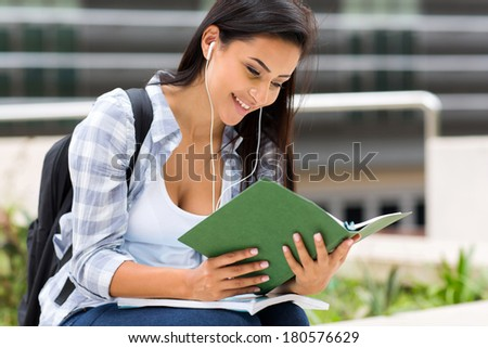 happy college student reading a book on campus - stock photo