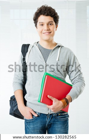 Happy College Student Smiling And Looking At Camera - stock photo