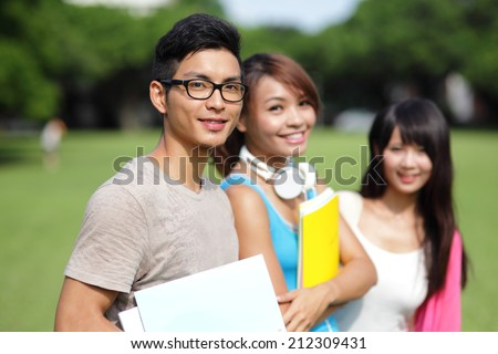 Happy College students smile to you on campus, asian - stock photo