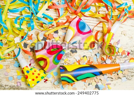 Happy, colorful party decoration on white wood background