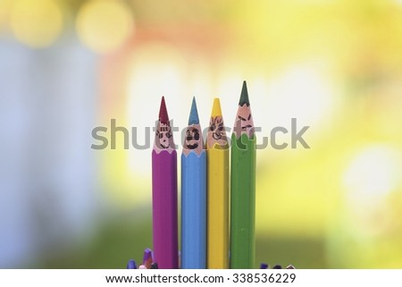 Happy colourful pencils on nature background  - stock photo