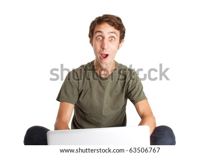 Happy computer user in a shocked reaction - stock photo