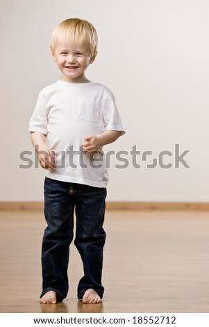 Happy, confident boy laughing - stock photo