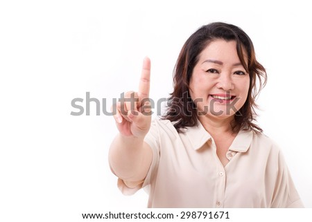 happy, confident middle aged woman pointing up one finger, number 1 hand sign gesture - stock photo
