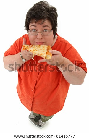 Happy confident obese forty-five year old woman on scale with slice of cheese pizza over white. - stock photo
