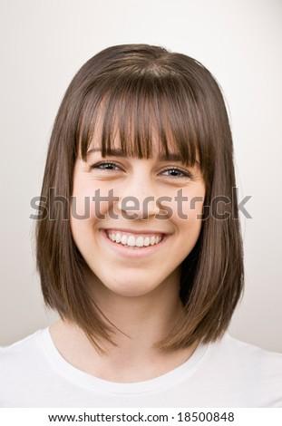 Happy, confident teenager smiling - stock photo