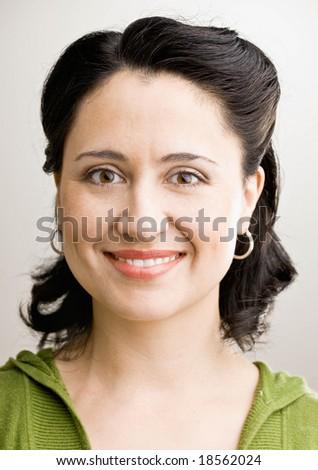 Happy, confident woman smiling - stock photo