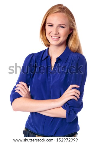 Happy confident young woman standing with her arms crossed smiling at the camera, upper body on white - stock photo