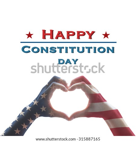 Happy constitution and citizenship day message with American flag red white blue star pattern on people hands in heart love shape on white background: USA patriotic, memorial, independence concept   - stock photo