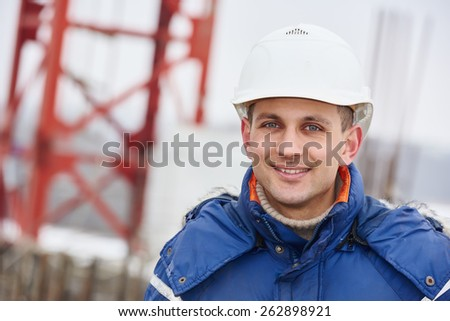 happy construction manager or building site foreman worker - stock photo