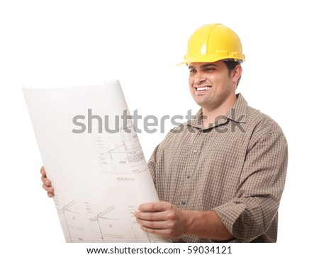 Happy construction worker reviewing blueprints