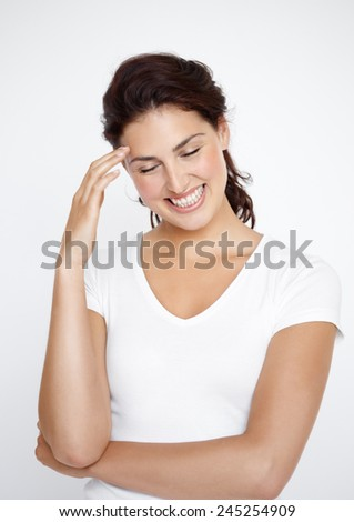 Happy contemplating young woman standing. - stock photo