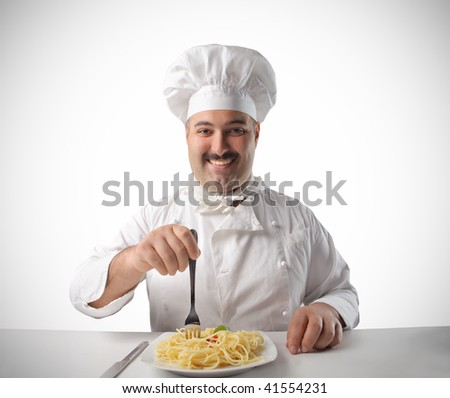 happy cook eating pasta