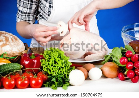 happy cook woman holds a Crude Hen - stock photo