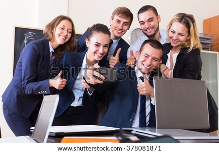 Happy corporate employees photoshooting together using mobile phone  - stock photo