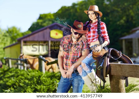 Happy couple a western style.Western love story.Western,cowboy,cowgirl,rodeo. - stock photo