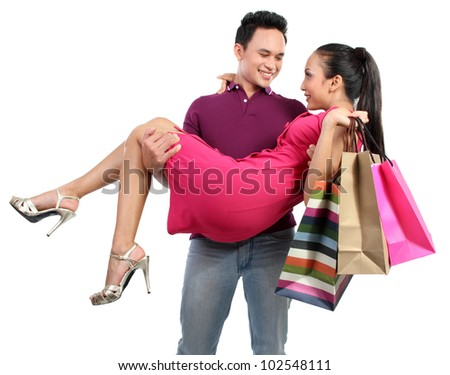 happy couple after shopping. isolated over white background - stock photo