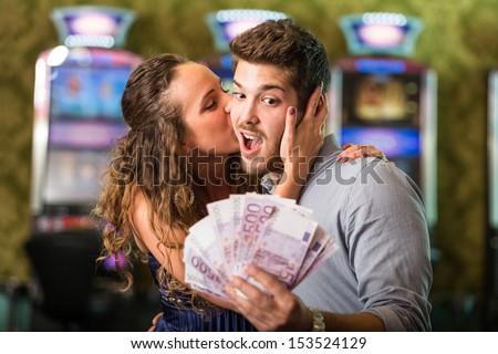 Happy Couple after Winning Money at Casino - stock photo