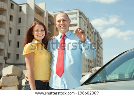 Happy couple against building new house    - stock photo