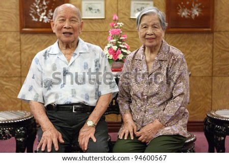 happy couple asian old man and woman - stock photo
