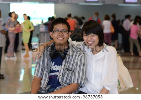 Happy Couple at Airport - stock photo